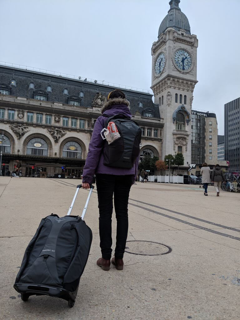 a23276297c7 Heading to catch a train in Paris with our favorite wheeled carry-on  backpack and its detachable daypack.